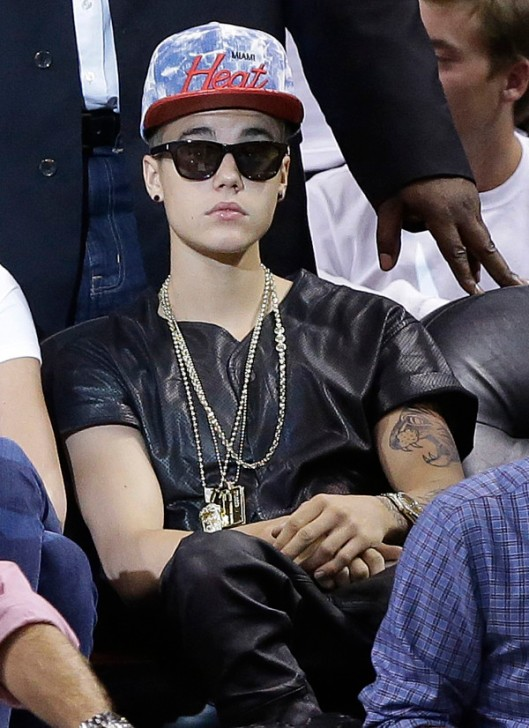 Singer Justin Bieber watches players during the first half of Game 7 in their NBA basketball Eastern Conference finals playoff series between the Miami Heat and the Indiana Pacers, Monday, June 3, 2013 in Miami. (AP Photo/Lynne Sladky)